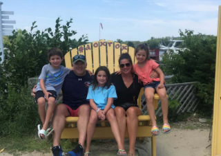 Picture of owner Tim O'Brien with his wife, Kerry, and their children