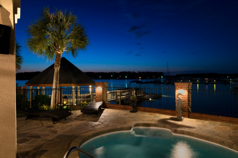 Backyard with pool and deck lighting