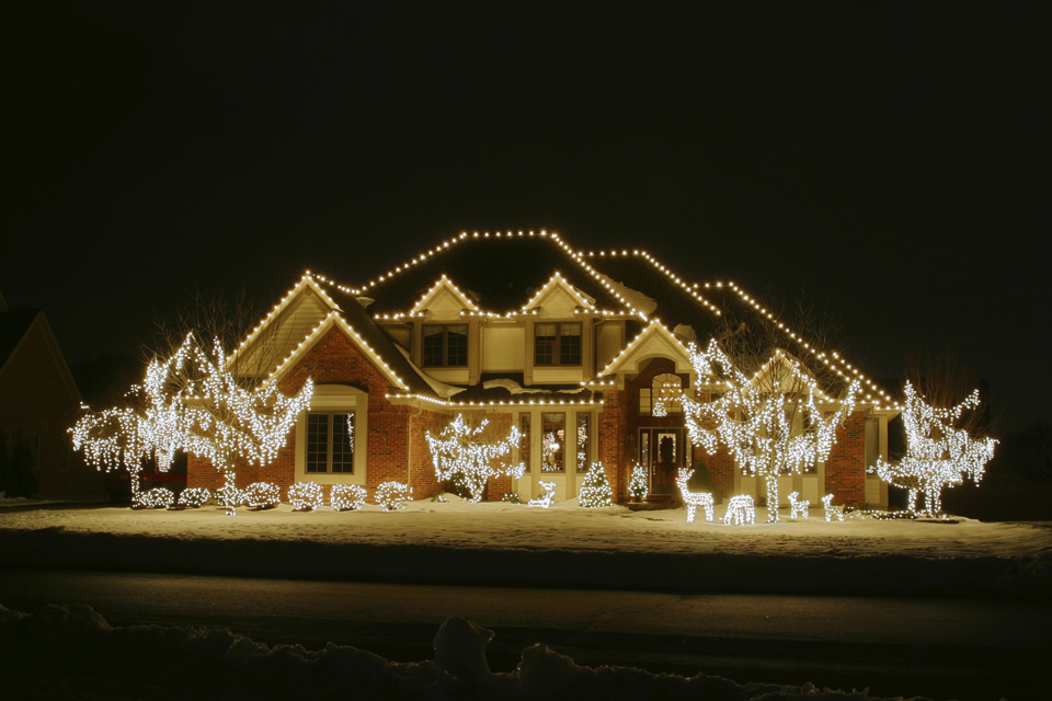 House with exterior Christmas lights installed