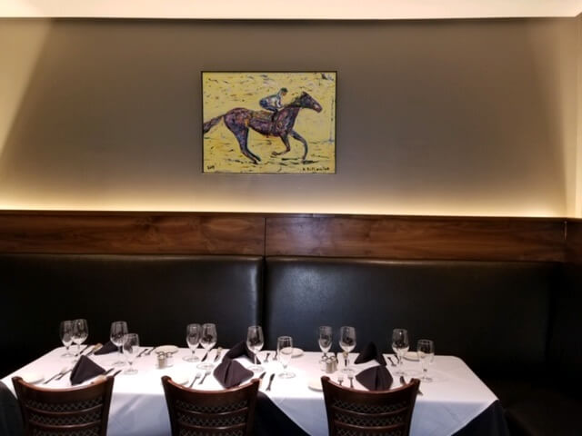 Horse painting and restaurant lighting