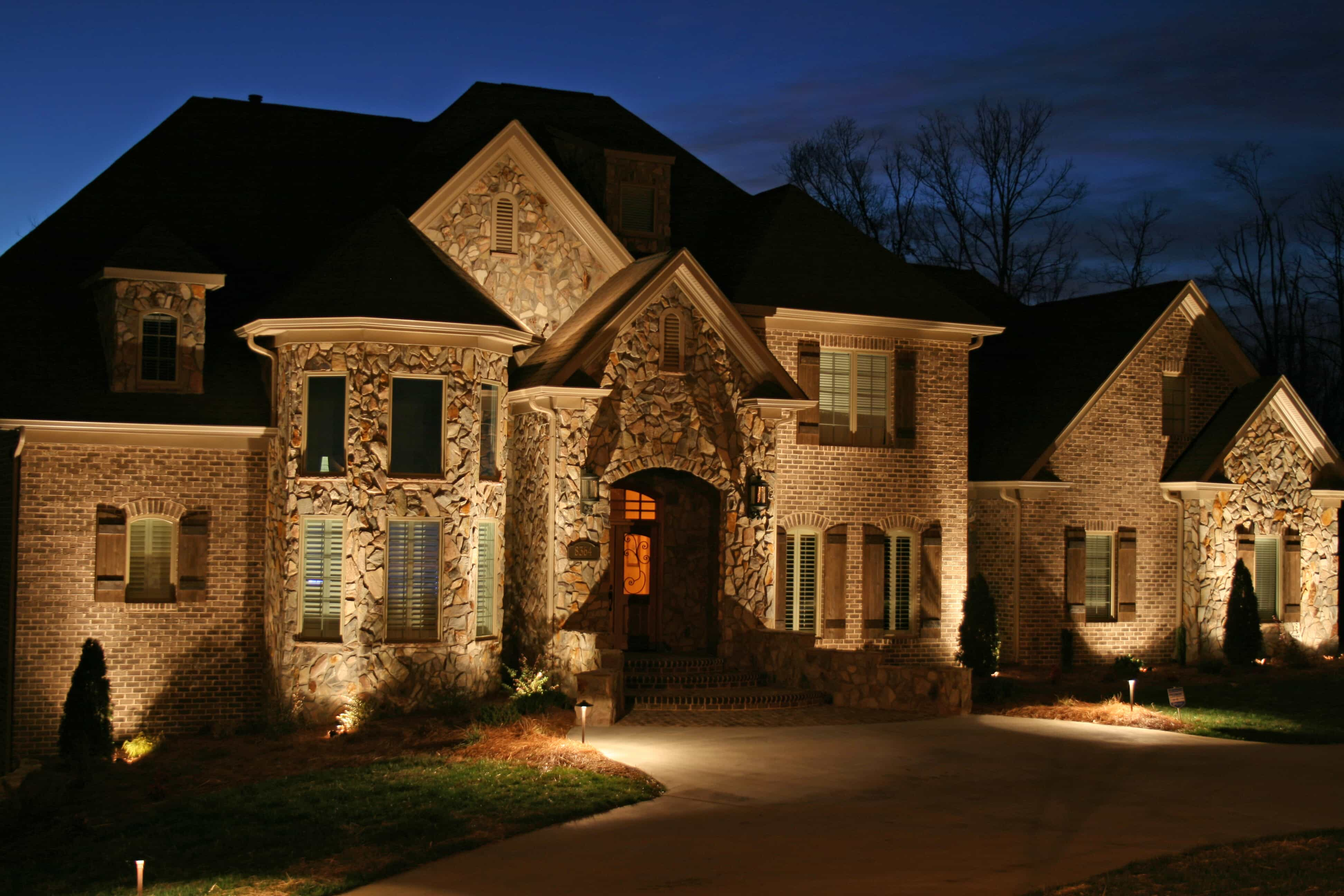 home with custom outdoor lighting
