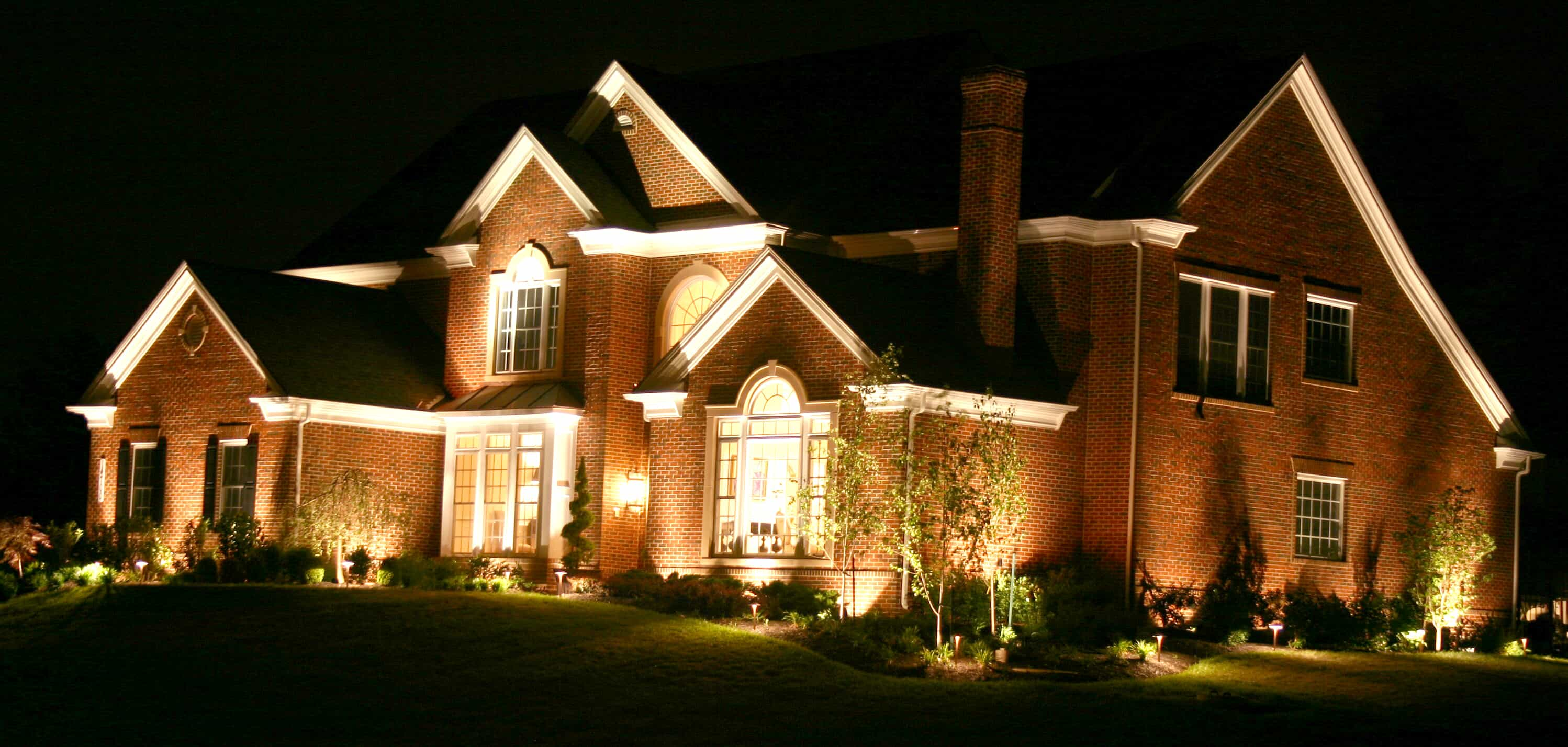 home with outdoor lighting