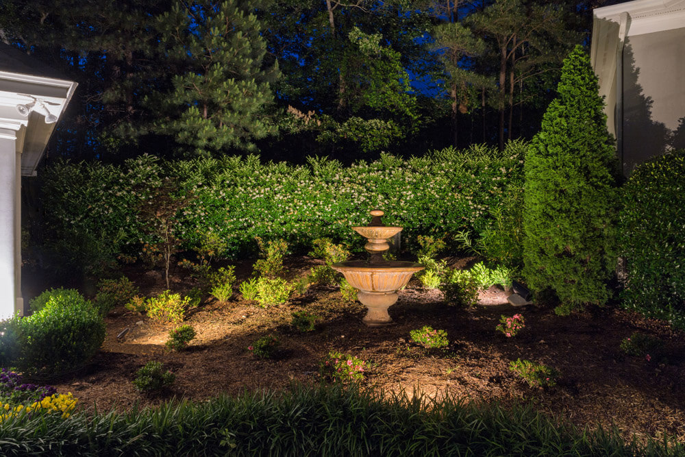 Garden lighting with a lit fountain