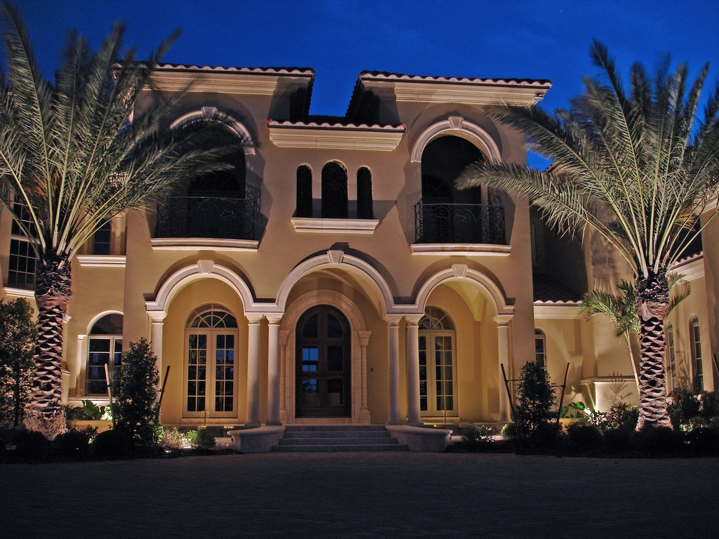 House with residential landscape lighting