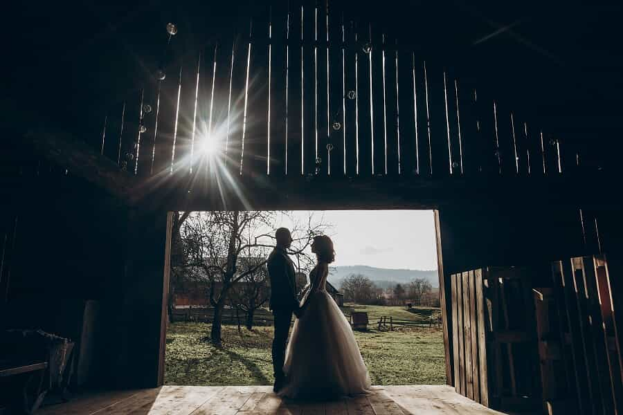 couple getting married in a barn