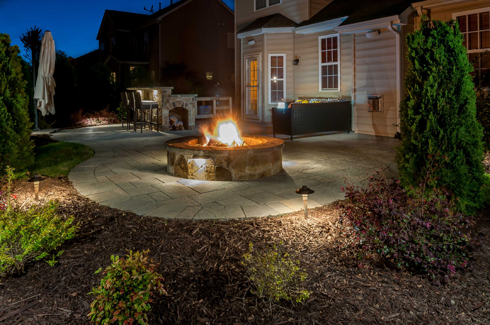 Backyard with firepit lighting