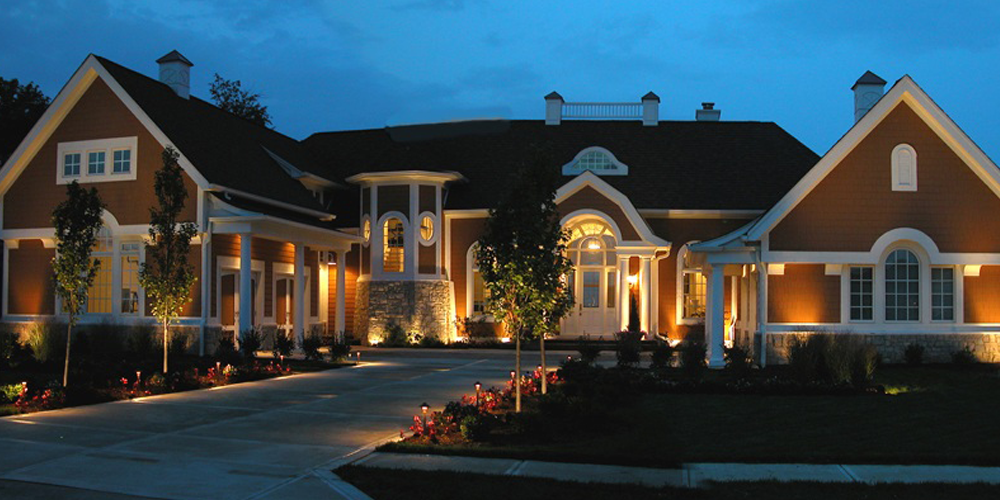 home with outdoor lighting installed