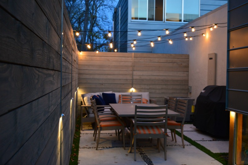 Backyard patio with market lights
