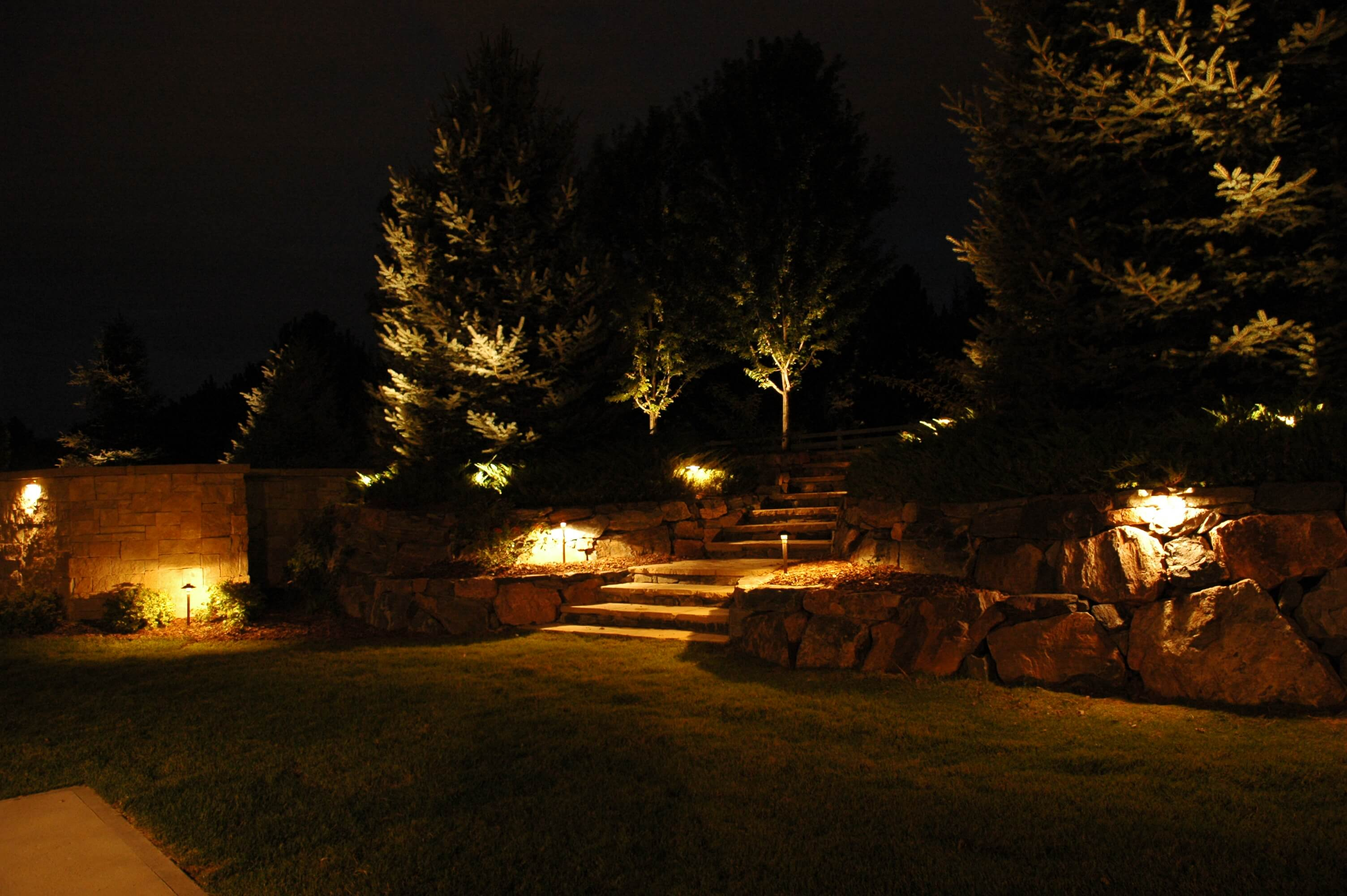 Lighted rock walls and trees