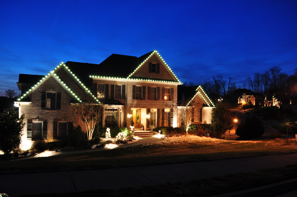 Exterior home with holiday lighting