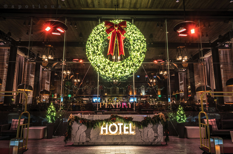 Interior commercial building with wreath holiday lighting