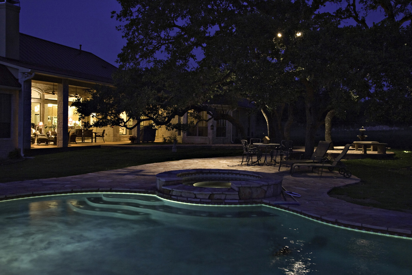 Backyard pool with lighting