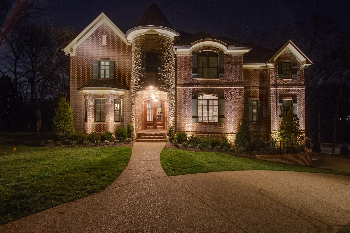 Exterior home with specialty lighting
