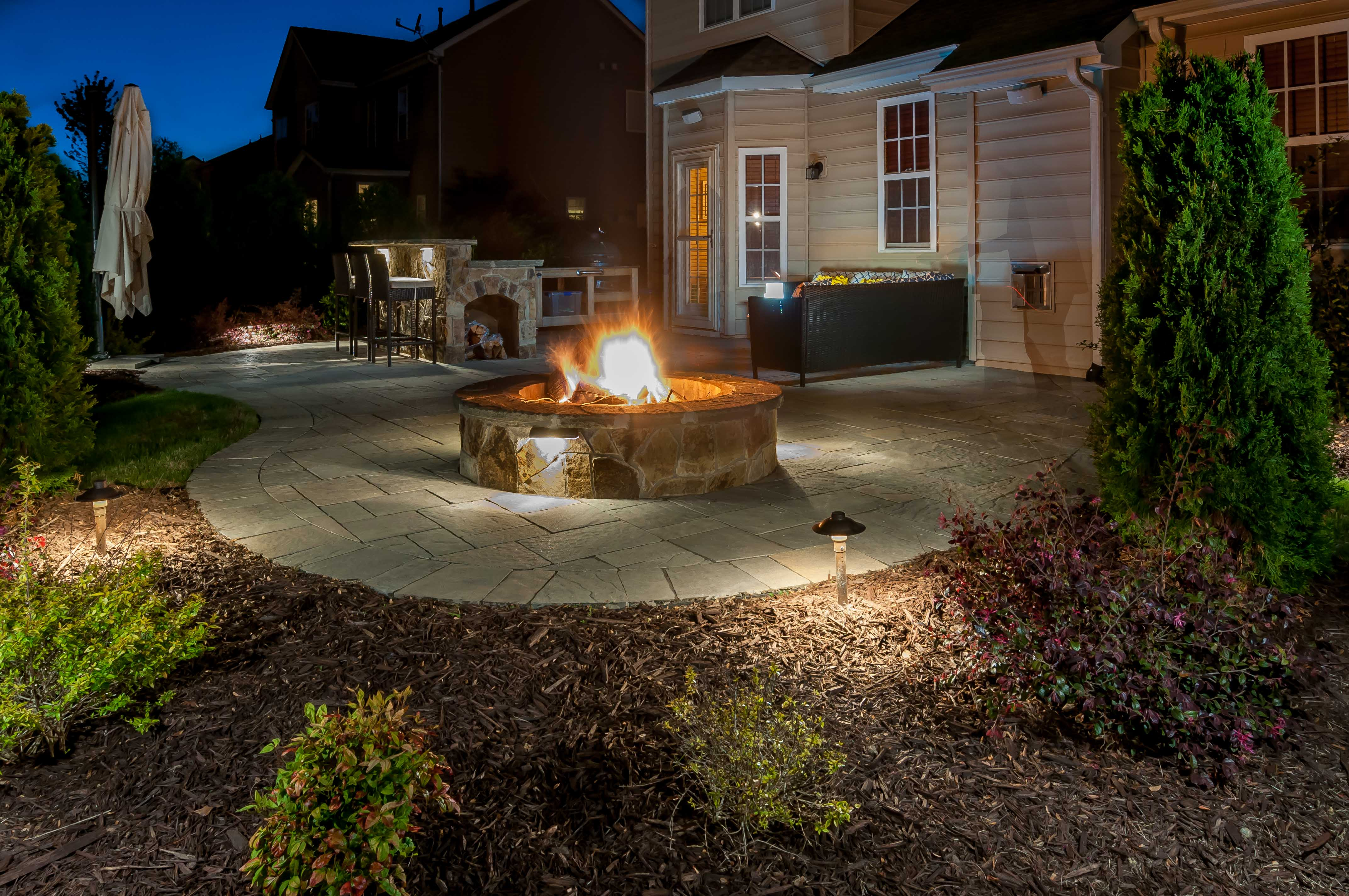 Patio and fire pit with lighting