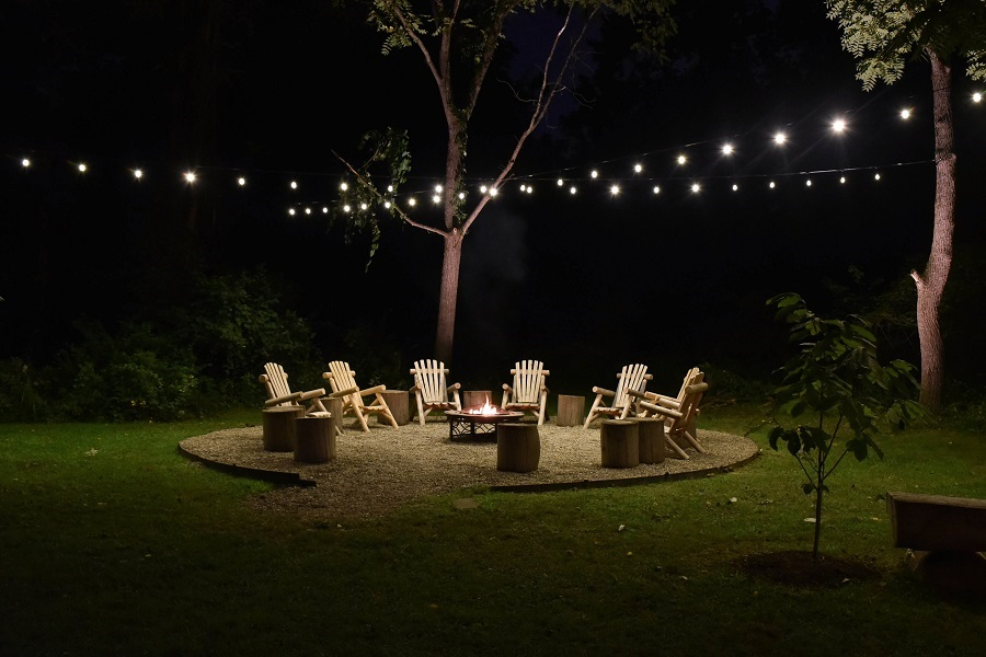 Outdoor seating area with festive lighting