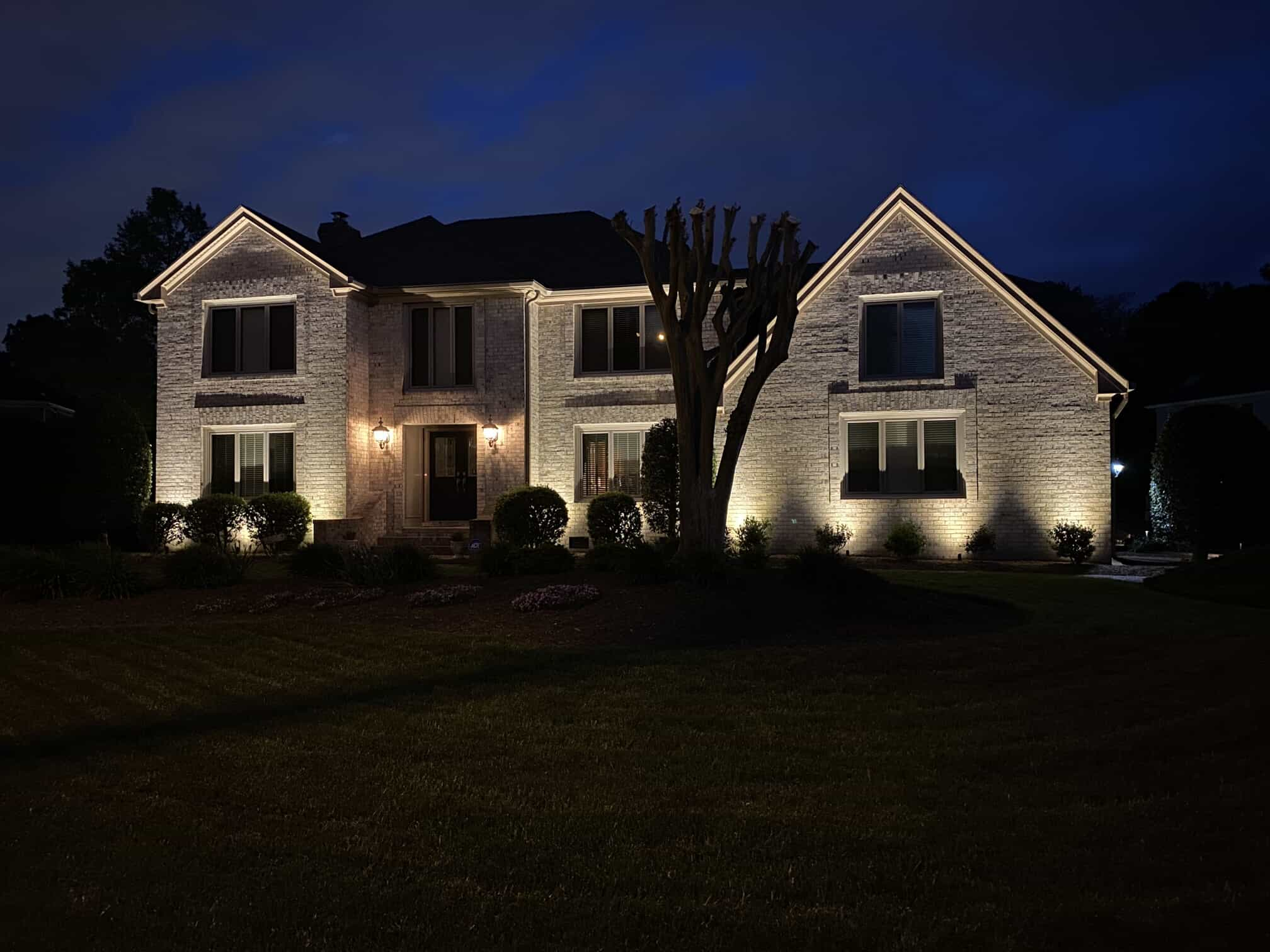 outdoor illuminating lights on a home at night