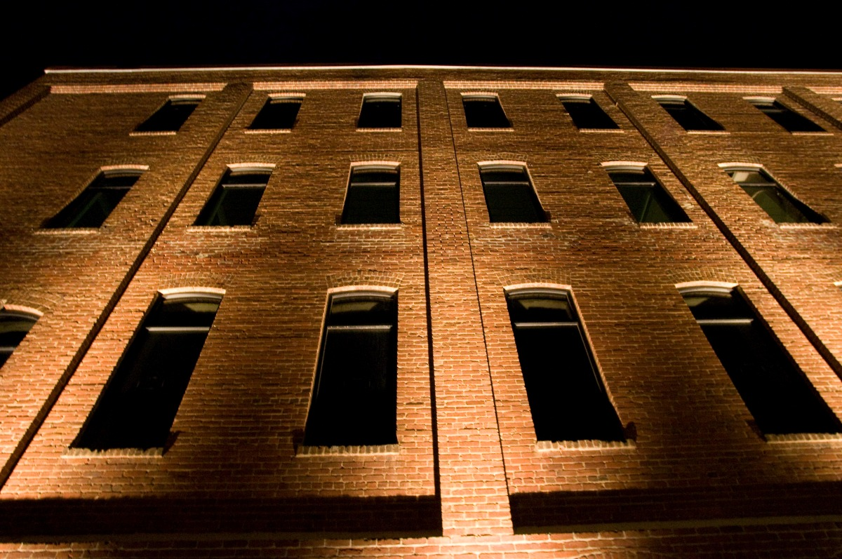 Illuminated windows on the side of a building