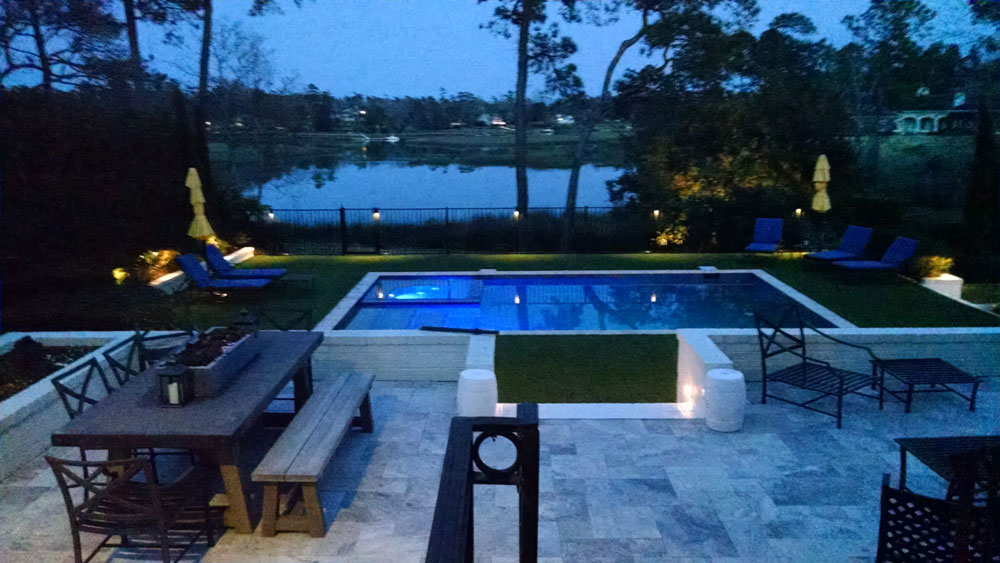 Pool area illuminated by Outdoor Lighting