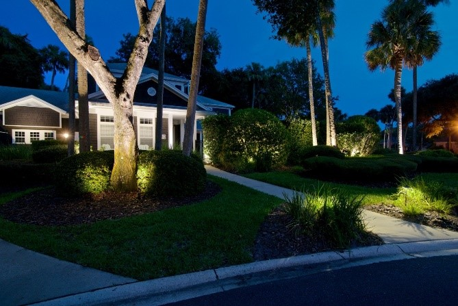 landscape lighting in front yard of a house