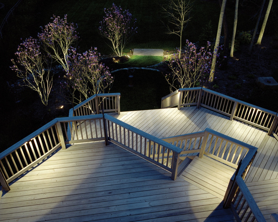 deck lighting surrounded by trees