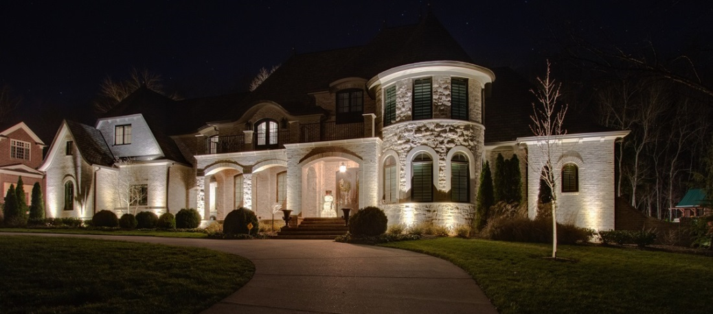 large white house with outdoor lighting