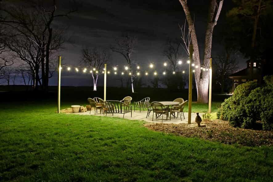 Outdoor patio & dining area with string lighting