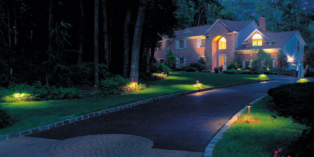 Home and driveway with specialty lighting