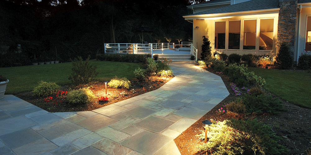 Pathway leading to a deck with special lighting