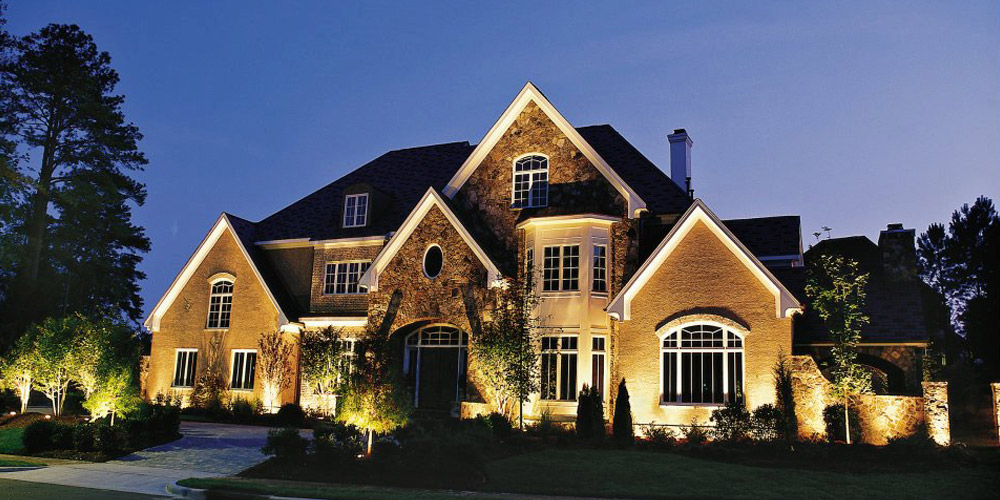 Front of large home with special lighting