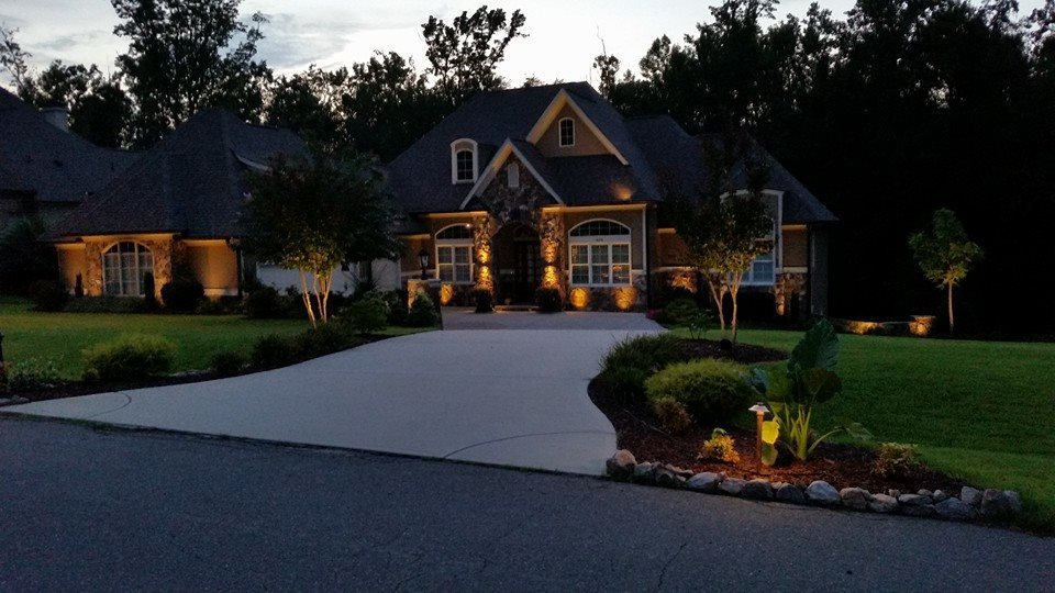 Front yard and driveway with lighting