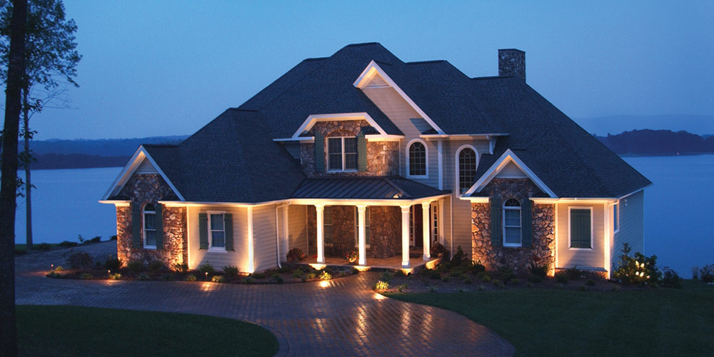 Residence that is next to lake and has specialty lighting