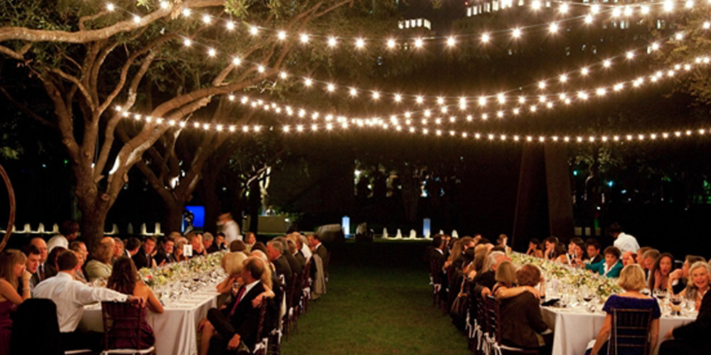 Outdoor reception with festive string lighting