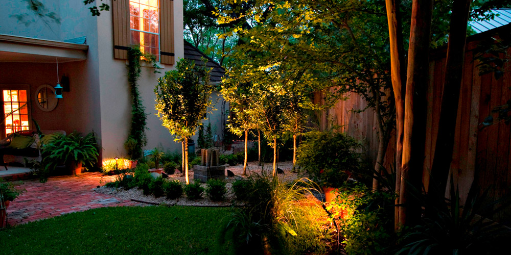 Backyard and patio with specialty lighting