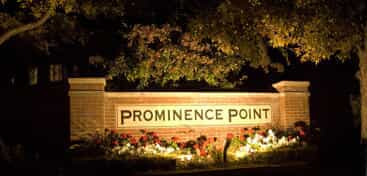Prominence Point sign illuminated by lights