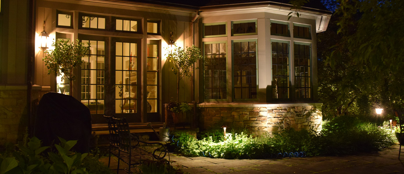 Landscape lighting design around patio in Powell OH