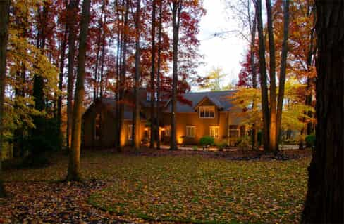 House in the middle of the woods with great outdoor lighting