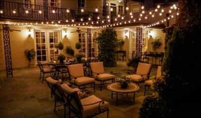 Outdoor patio with overhead twinkle lights and beautiful outdoor lighting