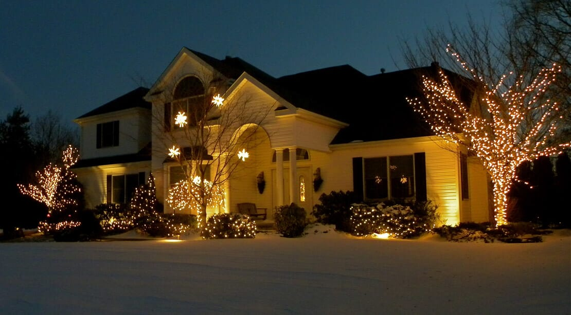 house with lights professionally decorated