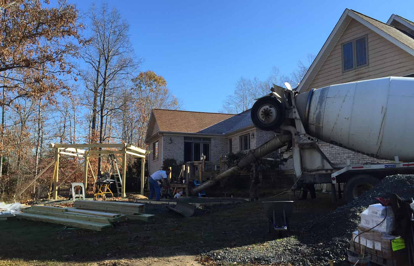 cement truck in front of house with gazebo under construction