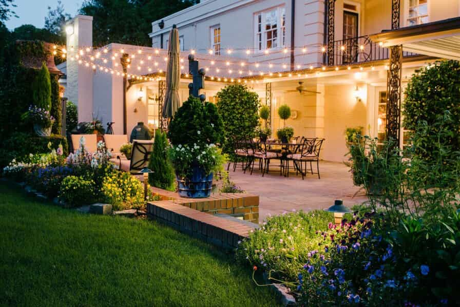 Backyard patio with festive lighting