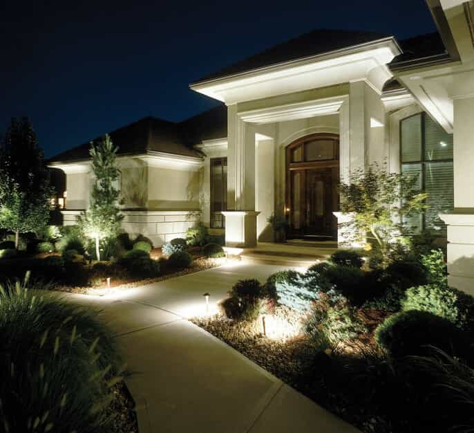 Home with landscape lighting