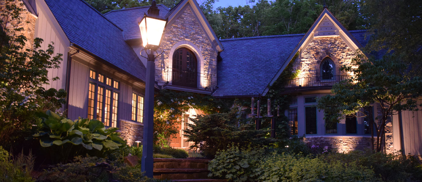 architectural lighting on the front of a stone house