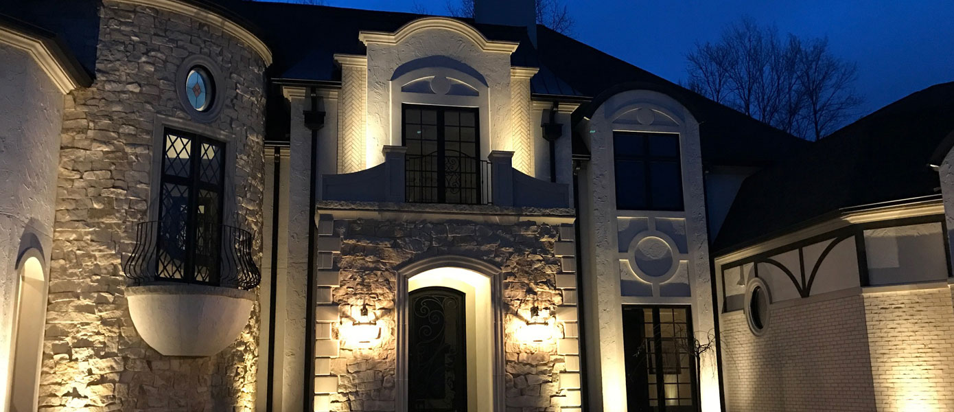 architectural lighting on a stone house