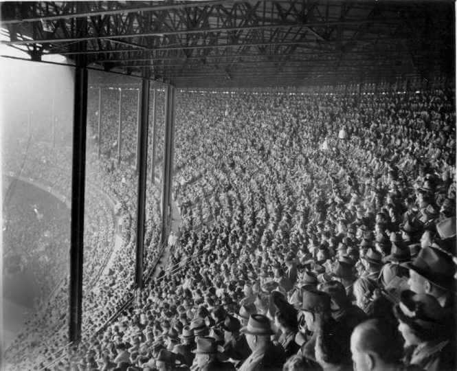 Black and white image of a stadium filled with people