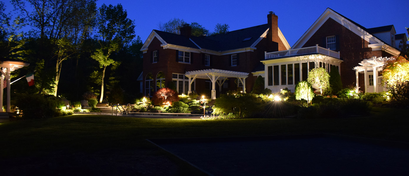 landscape and architectural lighting of a house and backyard