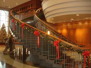 Christmas wreaths and garland on staircase
