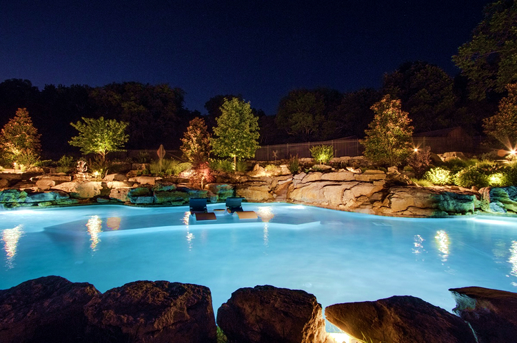 large pool with outdoor lighting