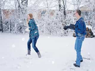 Couple having a snow ball fight