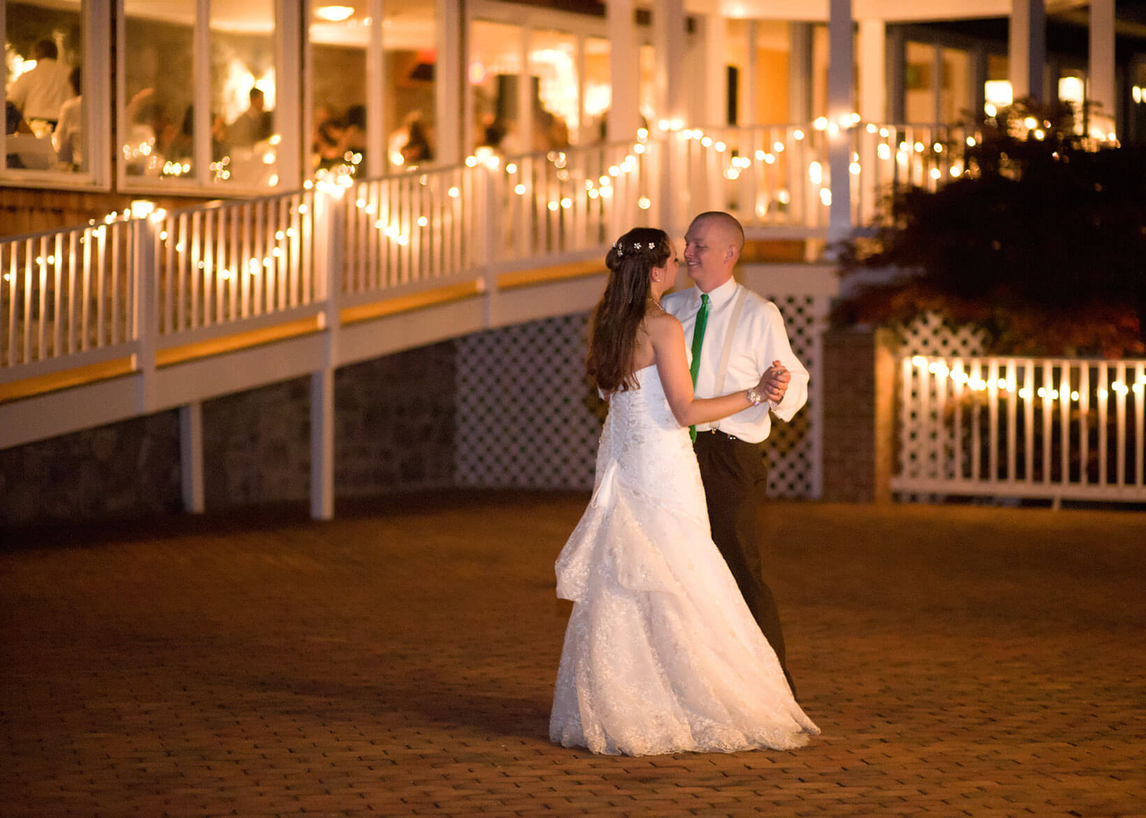 Couple dancing at well lit wedding