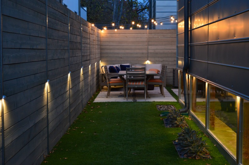 Outdoor area with a small patio and festive lights